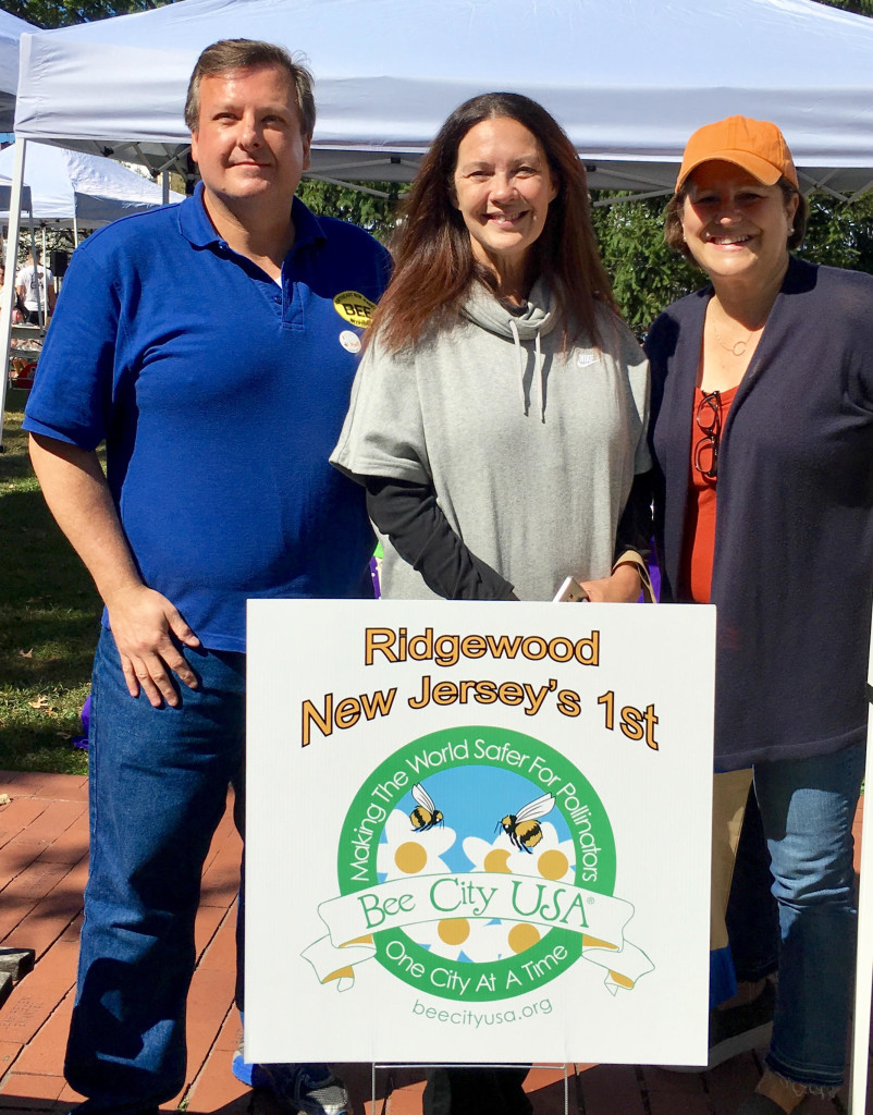 (In the photo, from left to right) Frank Mortimer, President, Northeast New Jersey Beekeepers Susan Knudsen, Mayor, Ridgewood Jennie Smith Wilson, Board of Education, Ridgewood